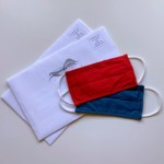 mail-in ballots with a red mask and a blue mask