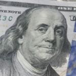 closeup on $100 bill with $50 bills
